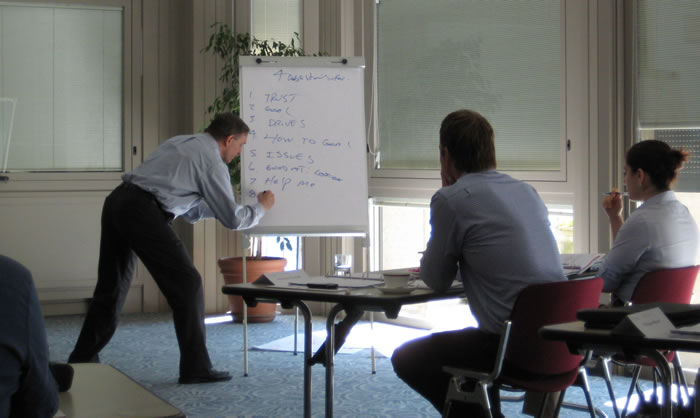 Marc conducting an employee training session at a small business